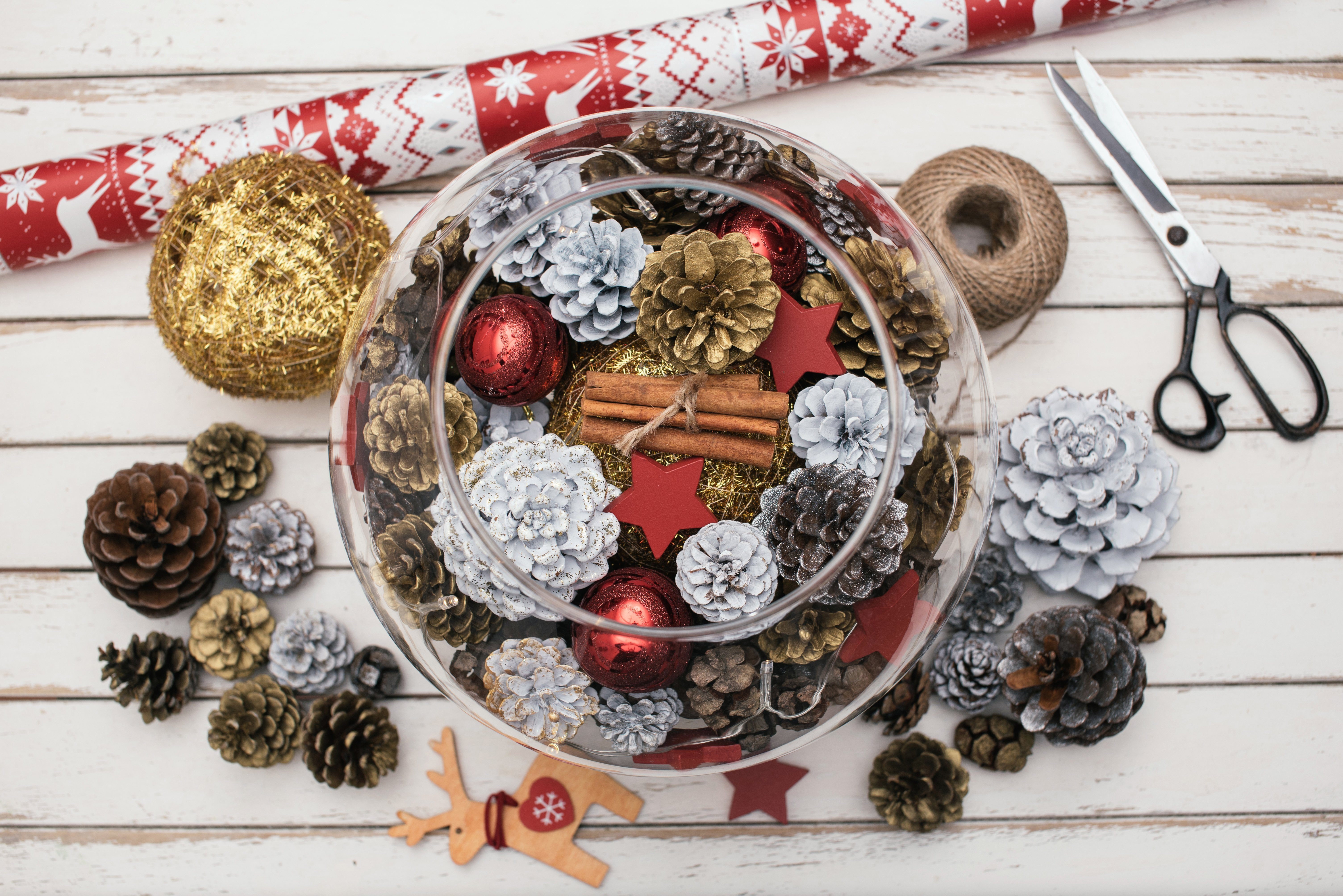 Decorating Christmas table with pine cones