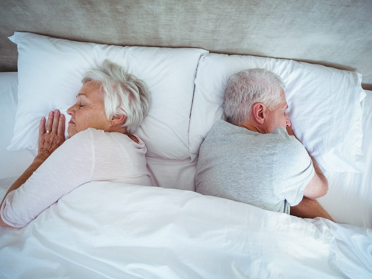 Things to Never Do After a Fight - Couple sleeping in bed away from each other