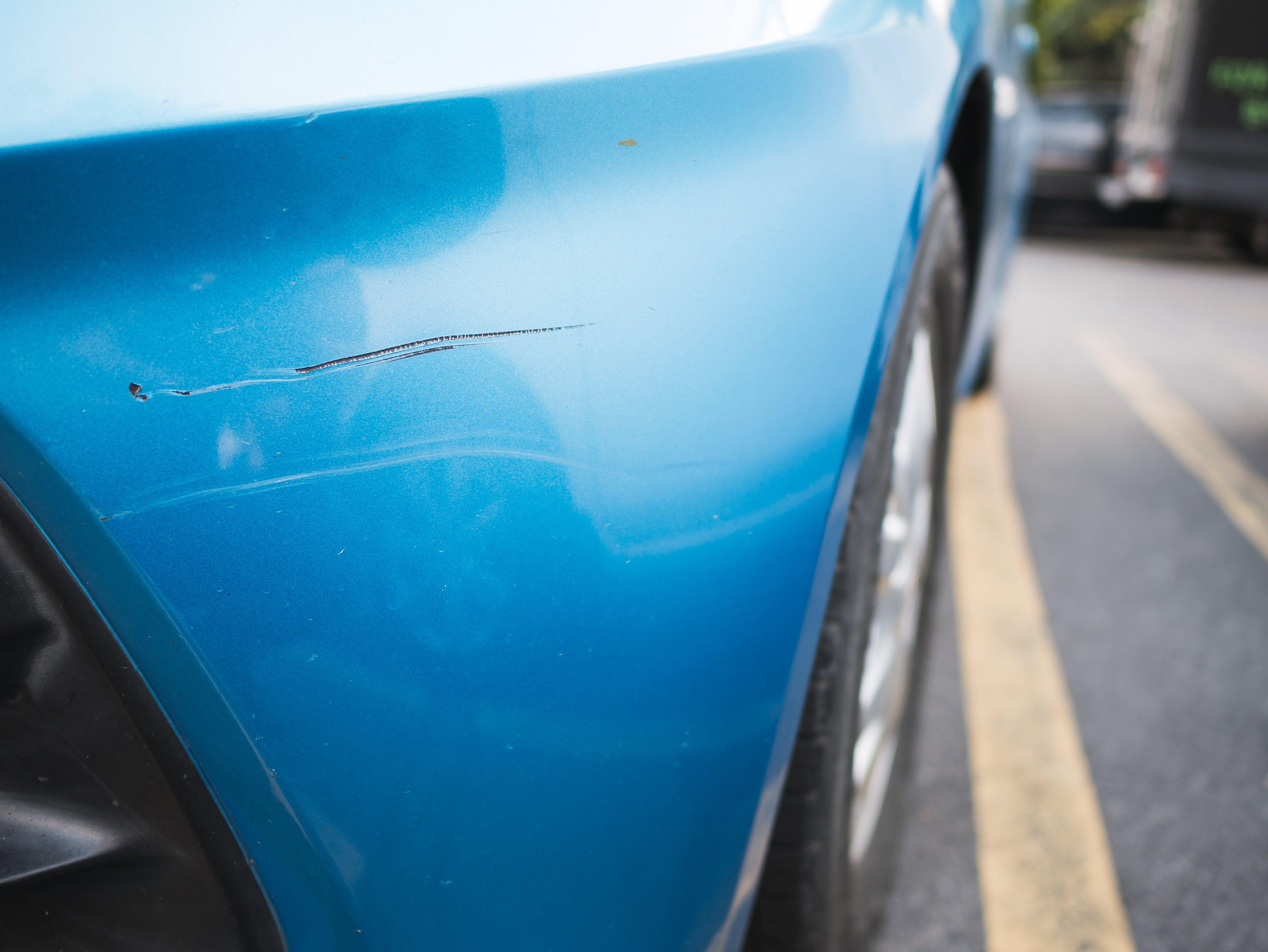 Scratch on the blue car