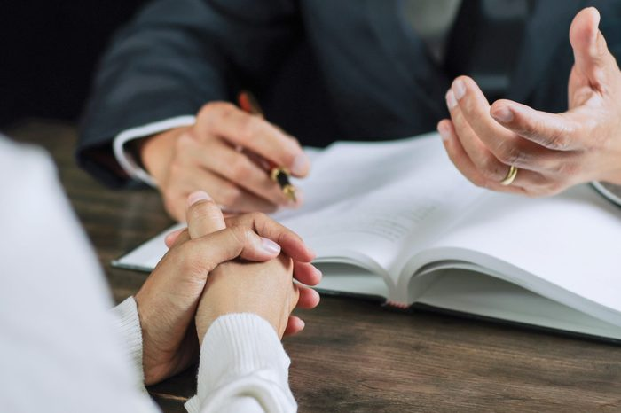 Justice lawyer consulting give a advice with client in courtroom.