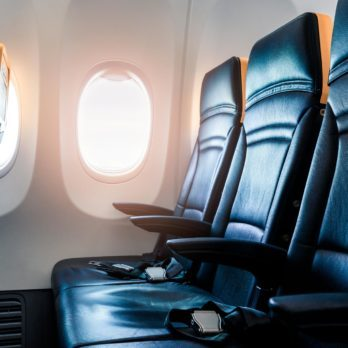 Case Closed: Here's Who Gets the Middle Seat Armrests on Planes