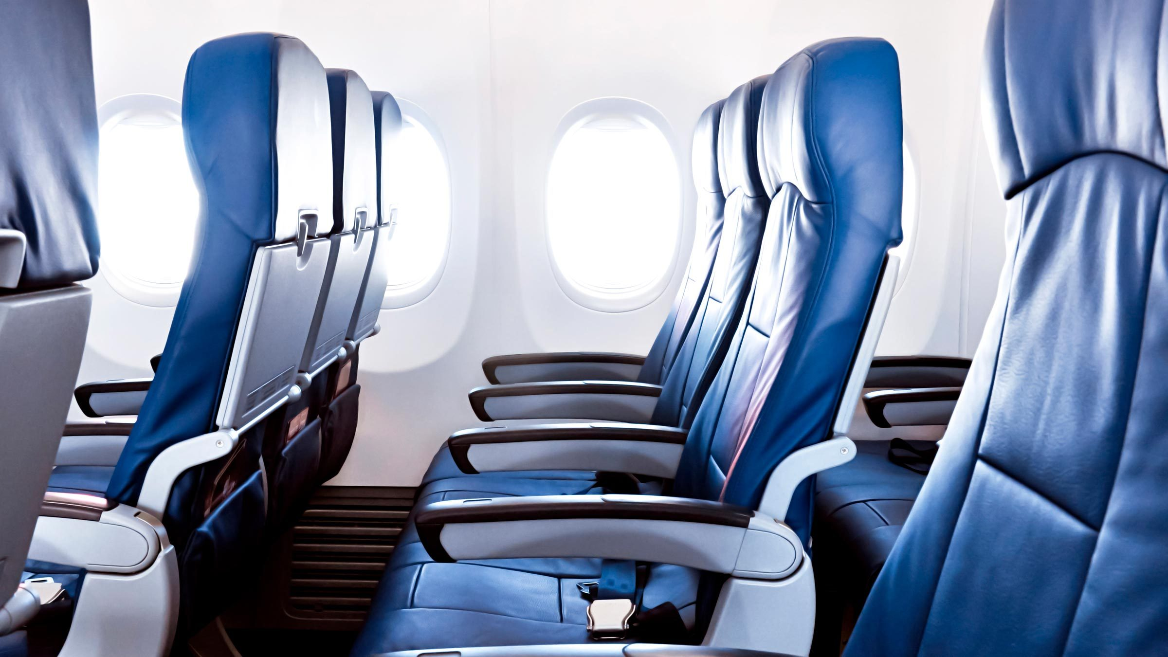 Empty airplane seats in the cabin