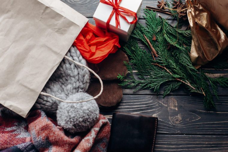 christmas shopping concept. big sale. seasonal rustic background with money credit cards wallet and bag with presents. advertising with space for text