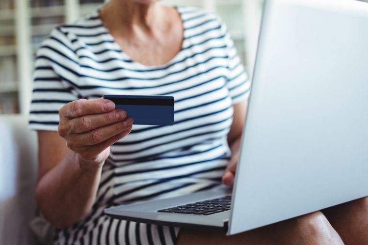 Senior woman doing online shopping on laptop at home