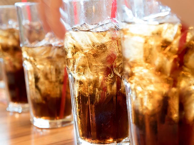 Worst hydration drinks - glasses of cola soda