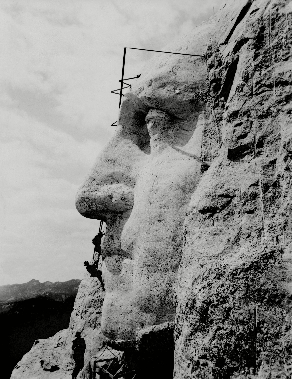 Workmen on face of George Washington at Mount Rushmore, South Dakota. 1932.