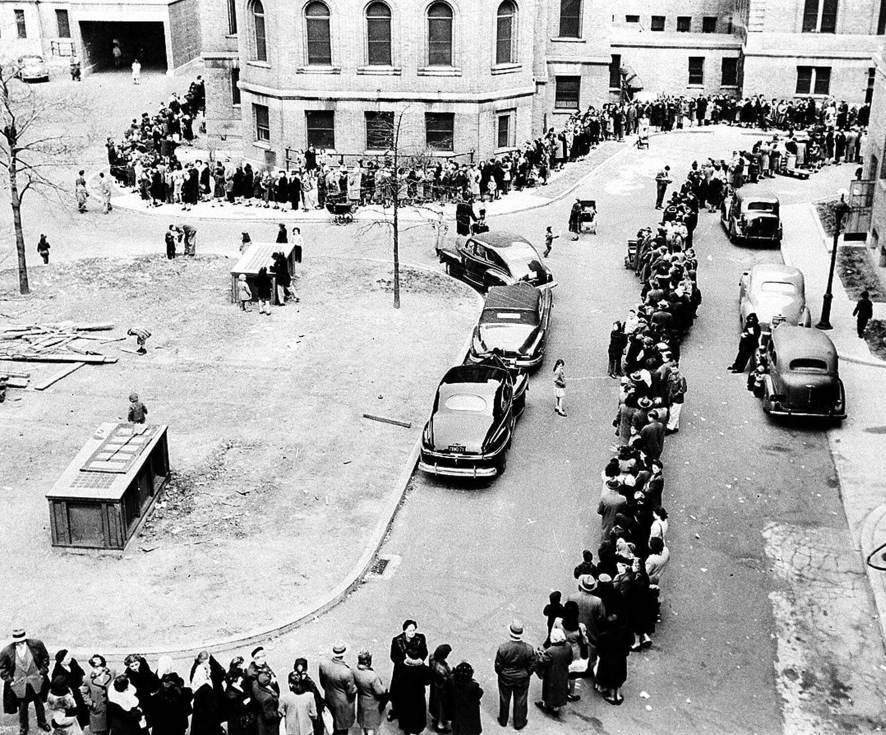 A long line of New Yorkers winds toward the entrance to Morrisania Hospital in the Bronx, New York April 14,1947, where doctors are innoculating against smallpox. They were attempting to half spread of the disease. Officials said city residents were being vaccinated at the rate of eight a minute