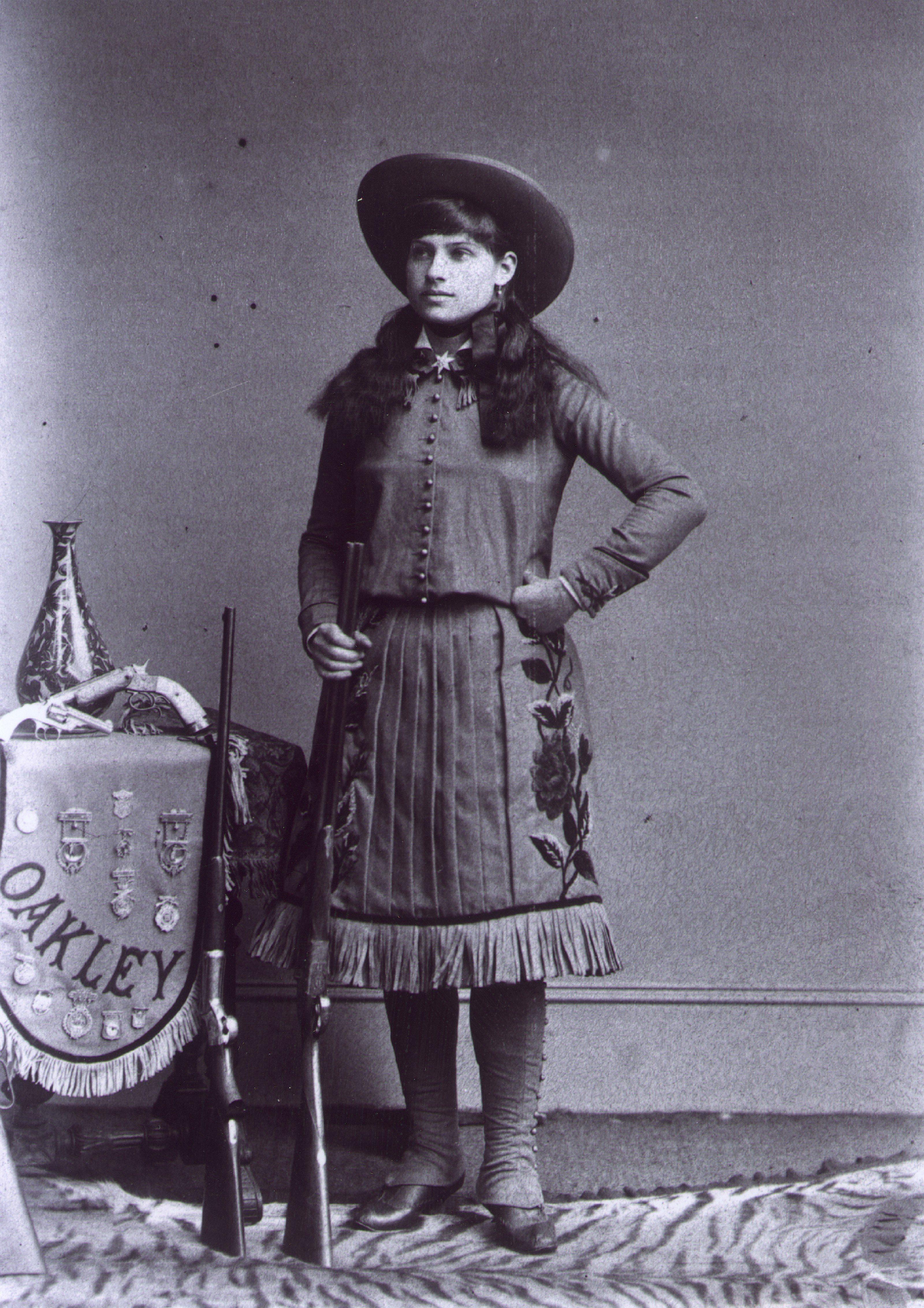 """Annie OAKLEY, 1860-1936, Wild West Show cowgirl called """"Little Sure Shot"""" c. 1885"""