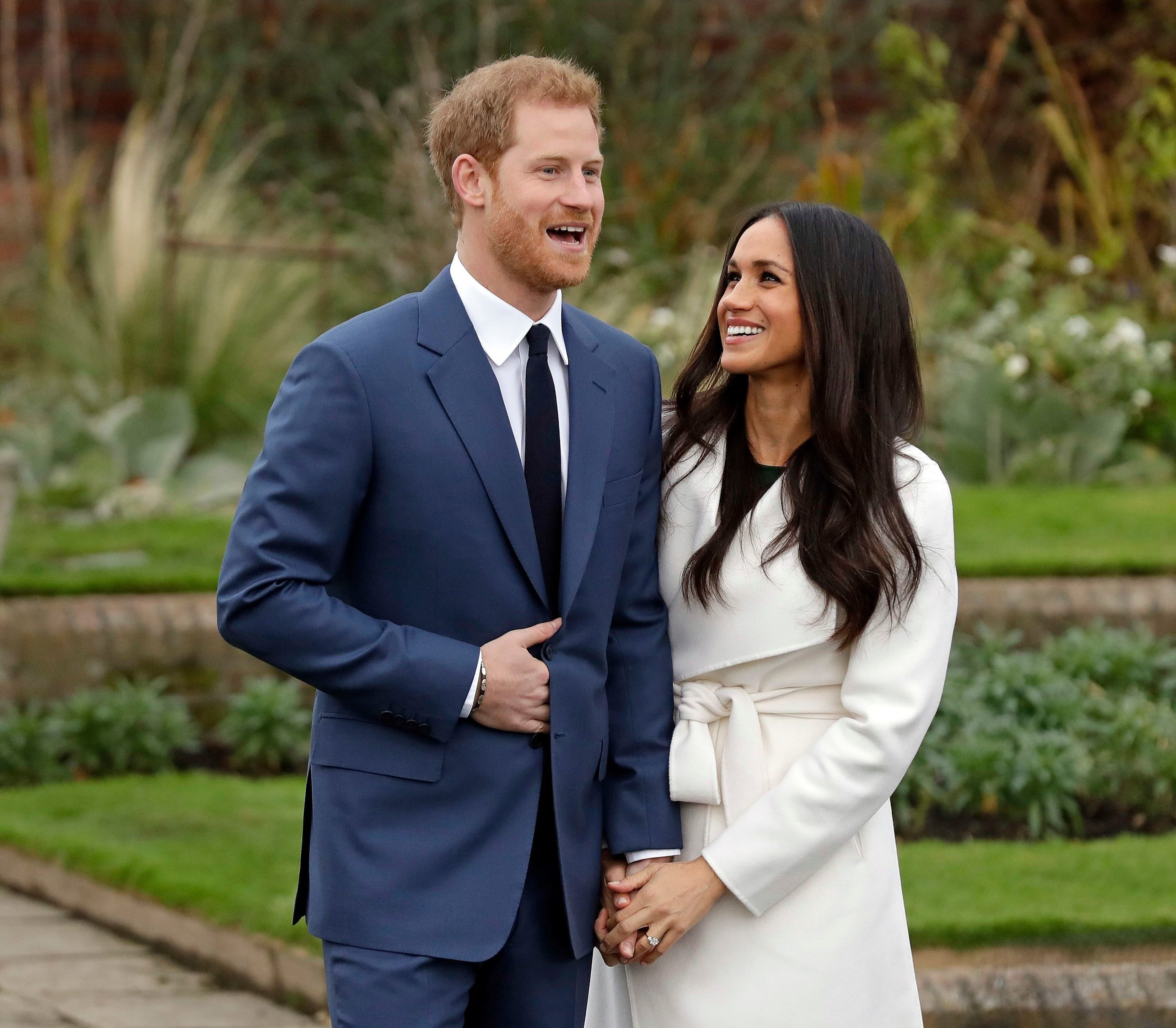 Mandatory Credit: Photo by AP/Shutterstock (9243663x) Britain's Prince Harry and his fiancee Meghan Markle pose for photographers during a photocall in the grounds of Kensington Palace in London, . Britain's royal palace says Prince Harry and actress Meghan Markle are engaged and will marry in the spring of 2018 Britain Royal Engagement, London, United Kingdom - 27 Nov 2017