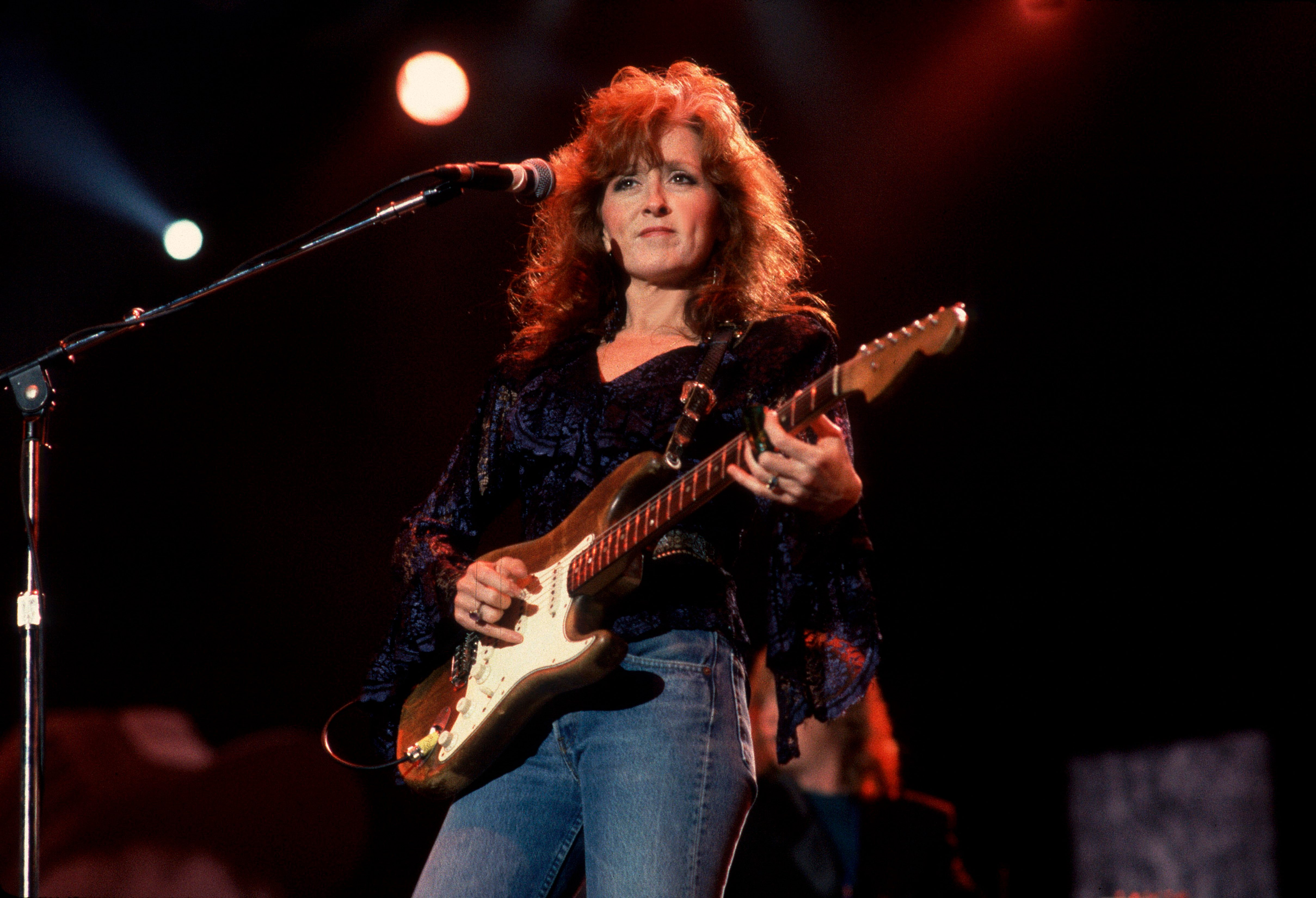 Bonnie Raitt performs at Farm Aid in the Hoosier Dome, Indianapolis, Indiana, April 7, 1990