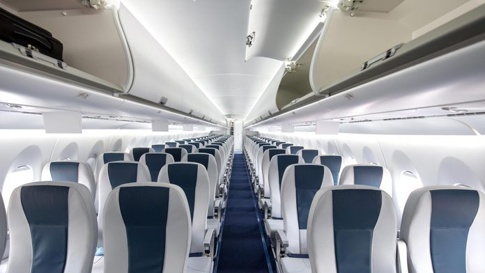 Interior of a large empty commercial passenger aircraft.