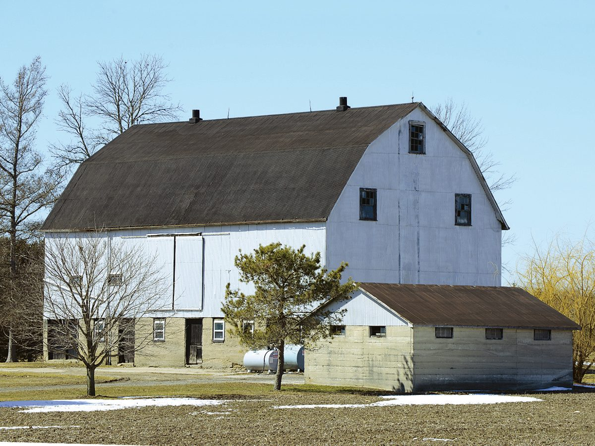 White barn with hip roof, St. Thomas, Ontario