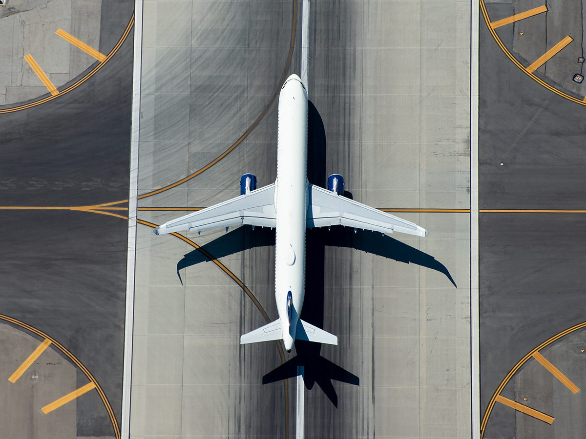 Aviation terms - airplane on runway overhead