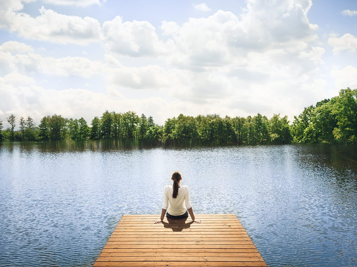 Benefits of being alone - woman alone on dock