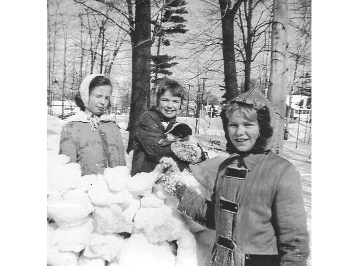 Louise (Wezie), Kathleen (Smokey) and Patricia building a snow fort