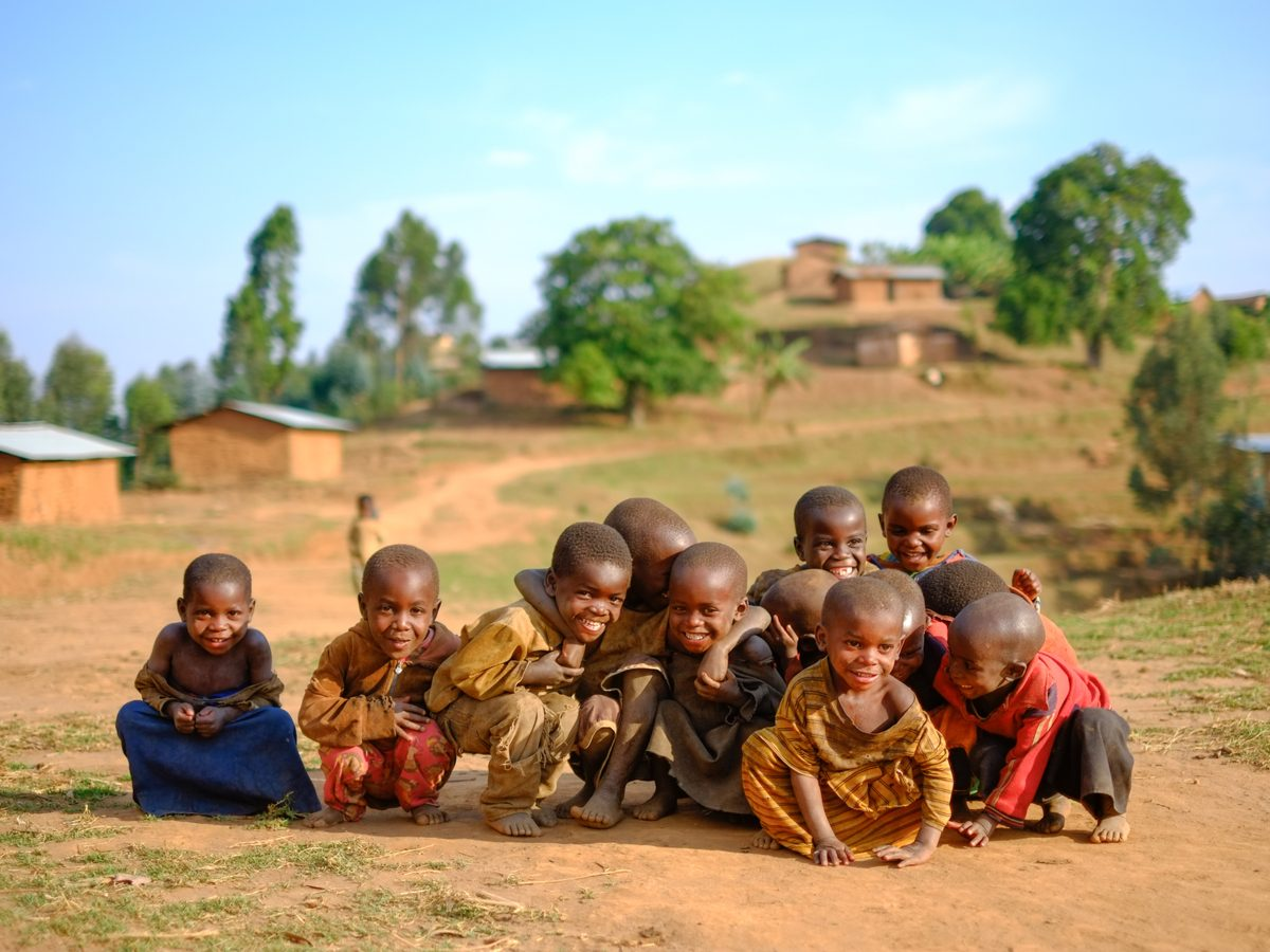 Group of children posing for photo in Rwandan village