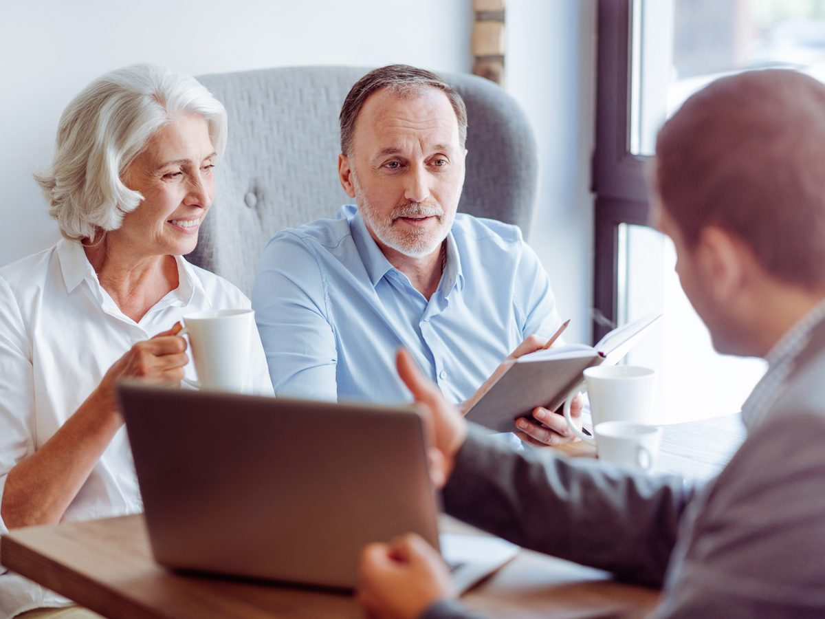 Financial advisor with middle-aged couple