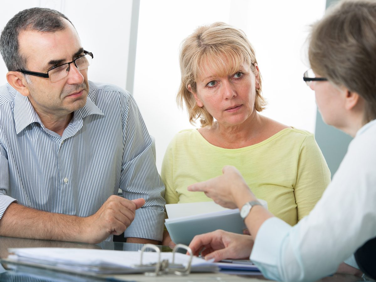 Financial advisor with middle-aged married couple