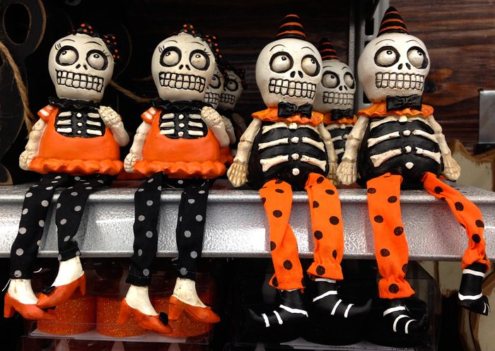 Small skeleton dolls in clothes on a shelf