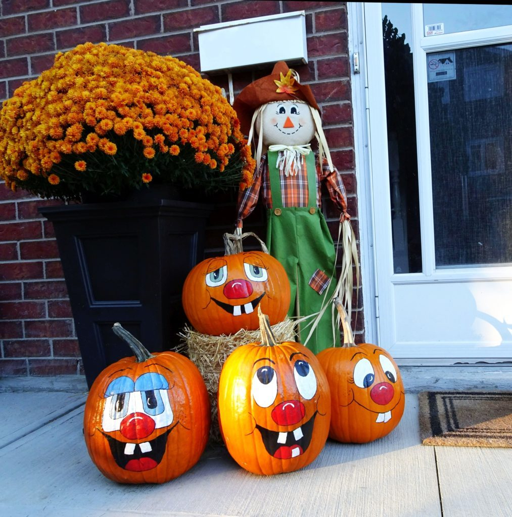 Pumpkins with smiling painted faces