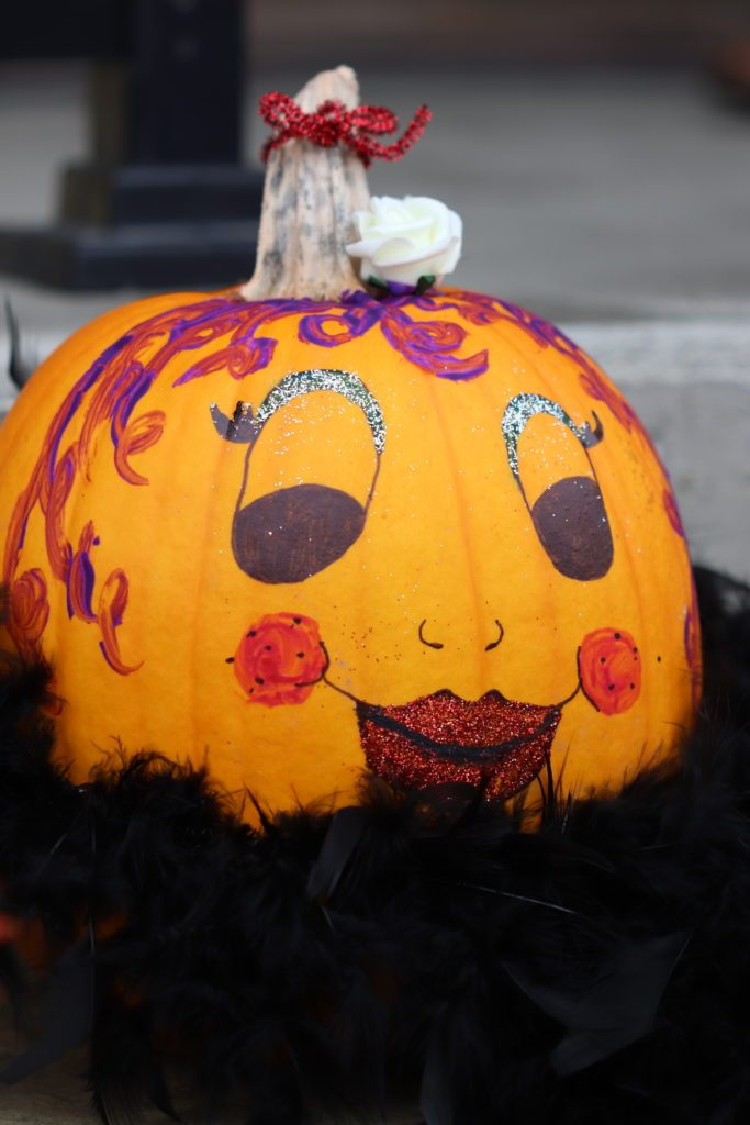 Pumpkin with smiling, made-up face