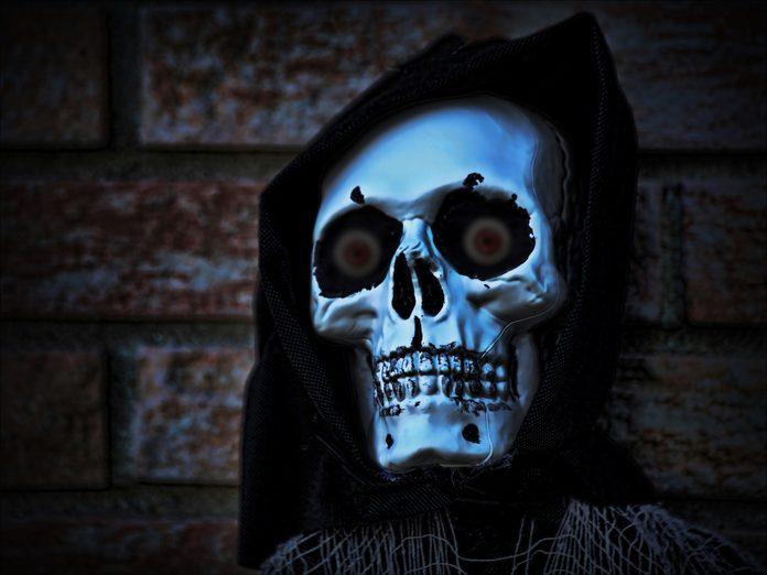 Face of a grim reaper wearing a hood