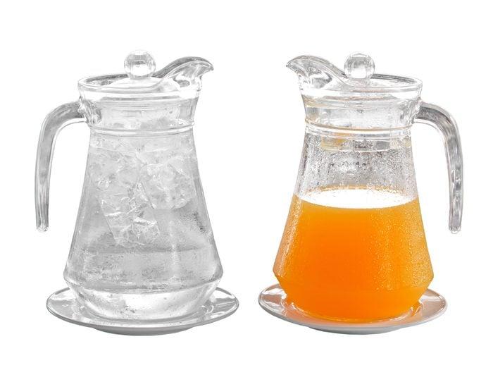 Jugs of water and orange juice