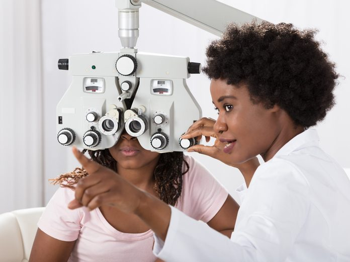 Woman and optometrist in eye exam