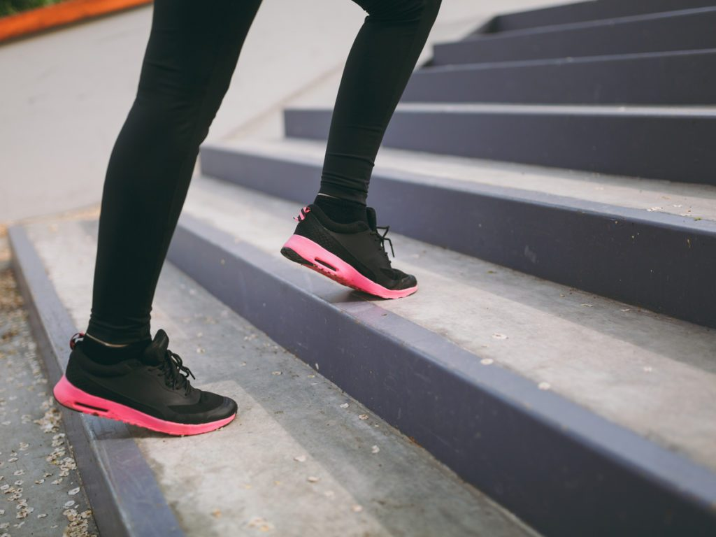 Sneakers of a person jogging up stairs
