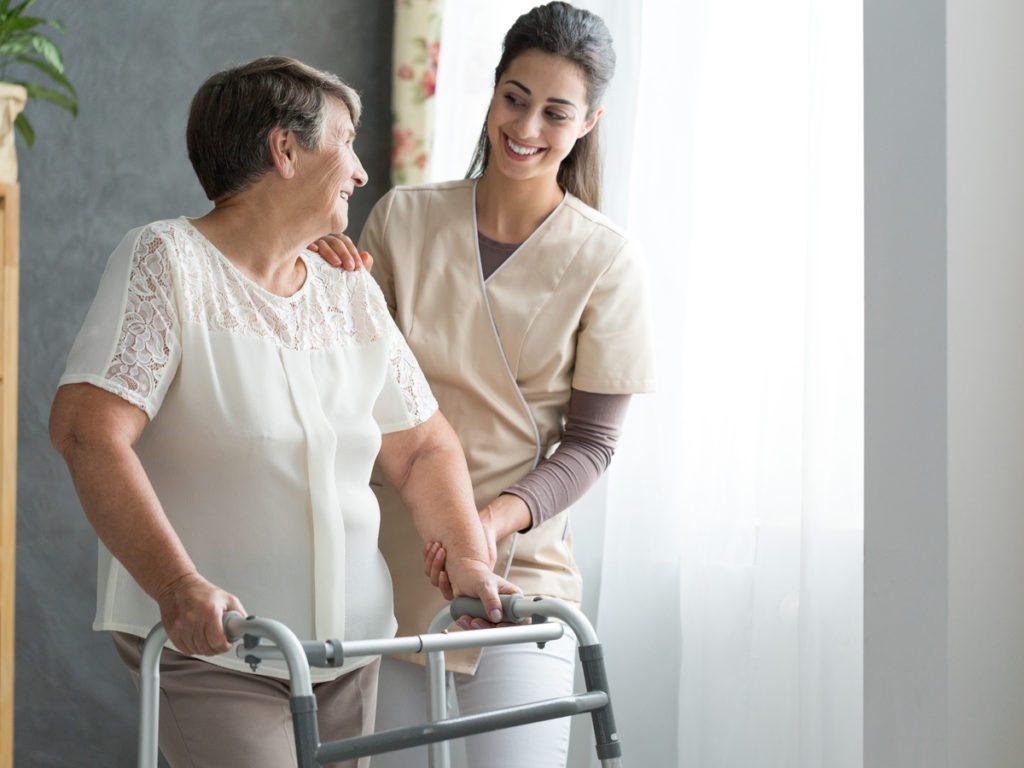 Woman holding walker