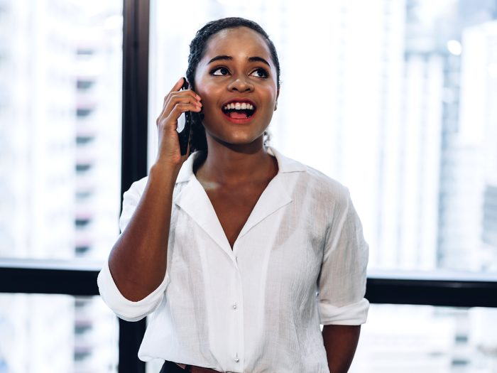 Woman standing in an office talking on the phone