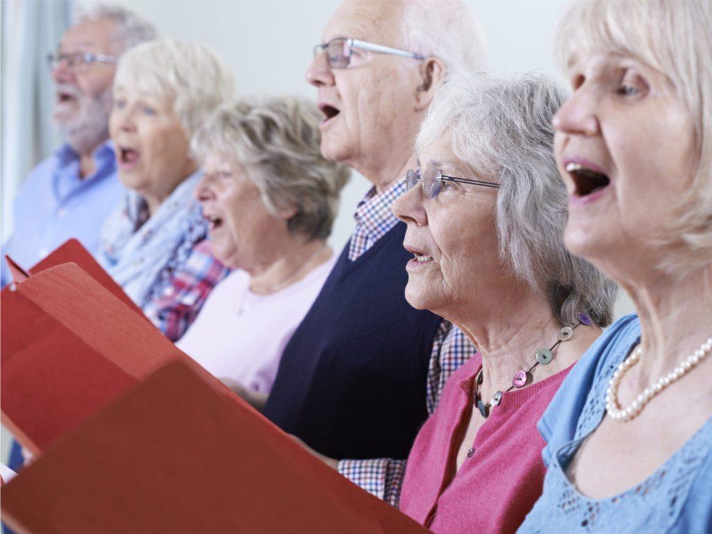 Six choir member singing