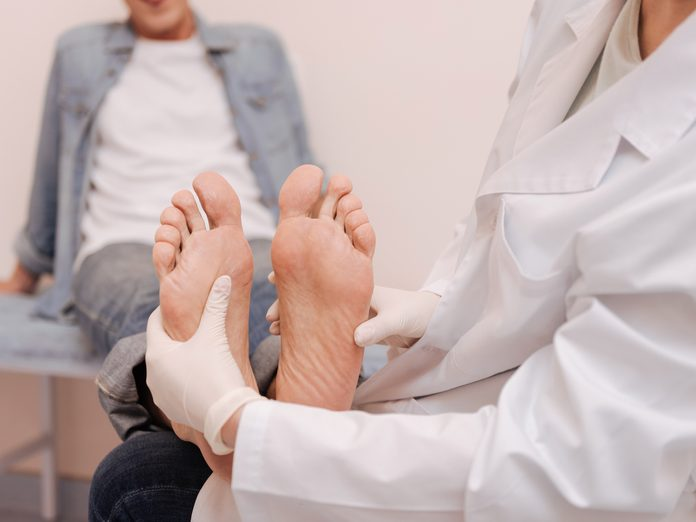 Doctor examining patient's feet