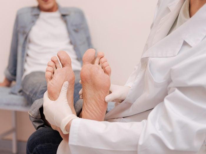 Doctor examining patient's feet