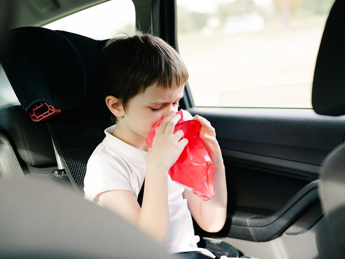 Motion sickness causes - child in car with nausea