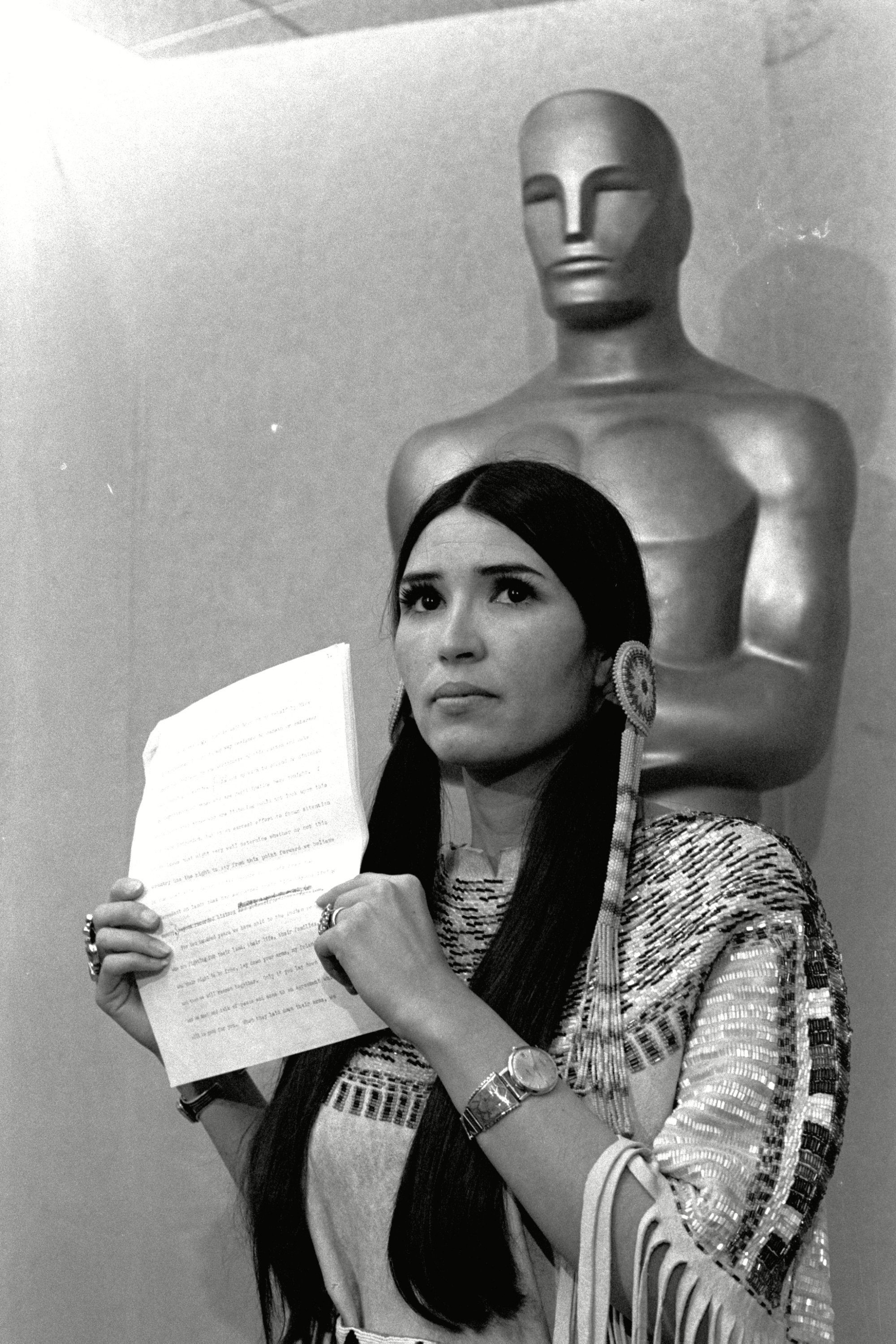 """Mandatory Credit: Photo by Uncredited/AP/Shutterstock (9427895a) Oscars Brando. Sacheen Littlefeather, tells the audience at the Academy Awards ceremony that Marlon Brando was declining to accept his Oscar as best actor for his role in """"The Godfather."""" The move was meant to protest Hollywood's treatment of American Indians Oscars-Politics, LOS ANGELES, USA - 27 Mar 1973"""