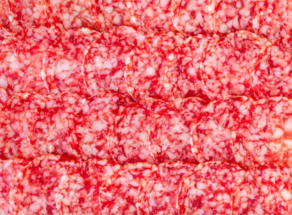 food background texture of salami close-up, top view