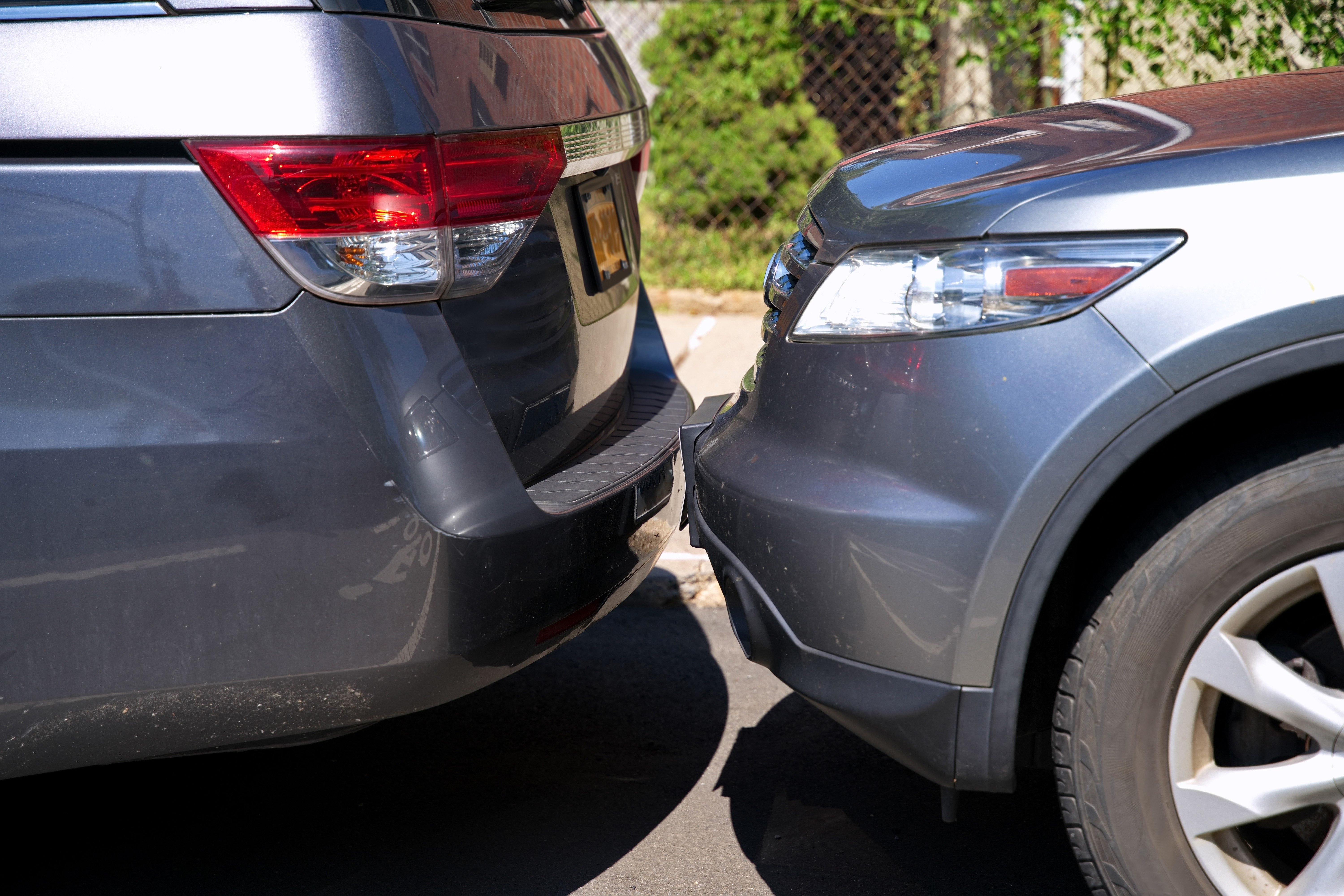 Cars touching bumpers at a residential parking lot is a typical sight living in a big congested city.