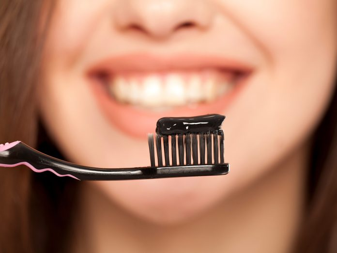 Activated charcoal toothpaste on toothbrush
