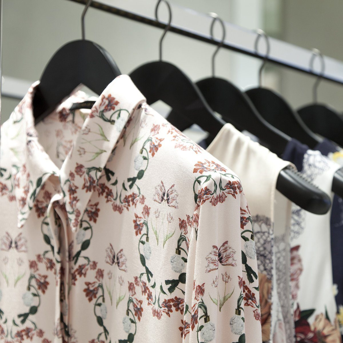 woman blouse hangs on a hanger