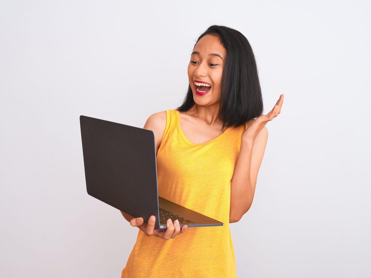 Woman carrying laptop