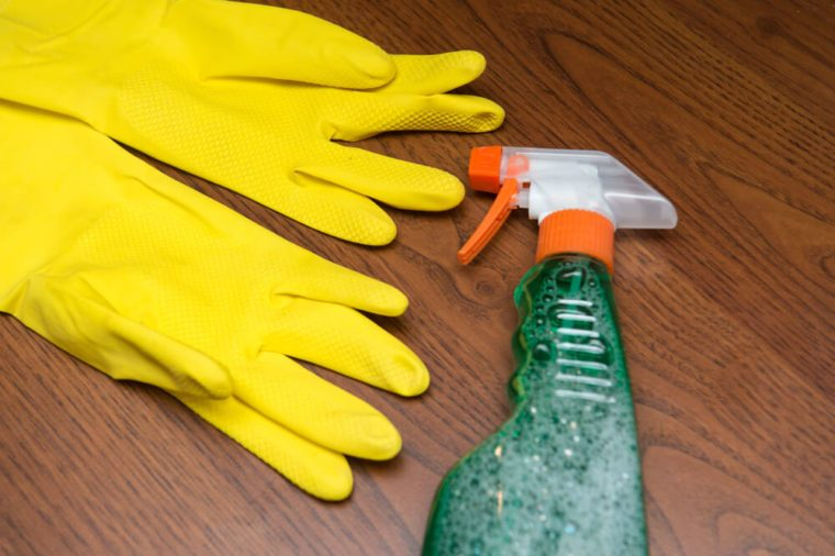 Cleaning concept. Cleaning tools: spray, rubber gloves and sponge