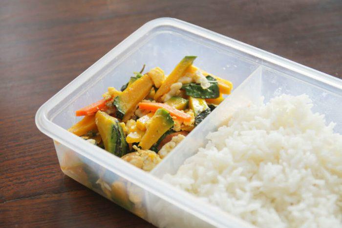 tupperware box.Lunch Box.Stir fried pumpkin and pork with rice