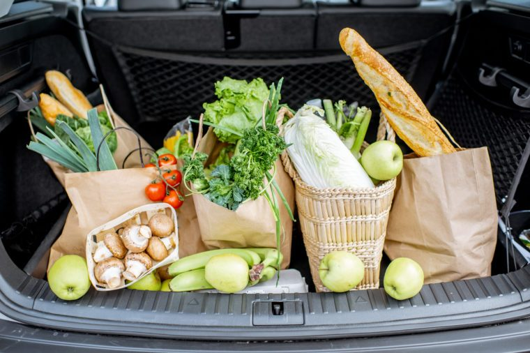 Car trunk with shopping bags full of fresh and healthy food