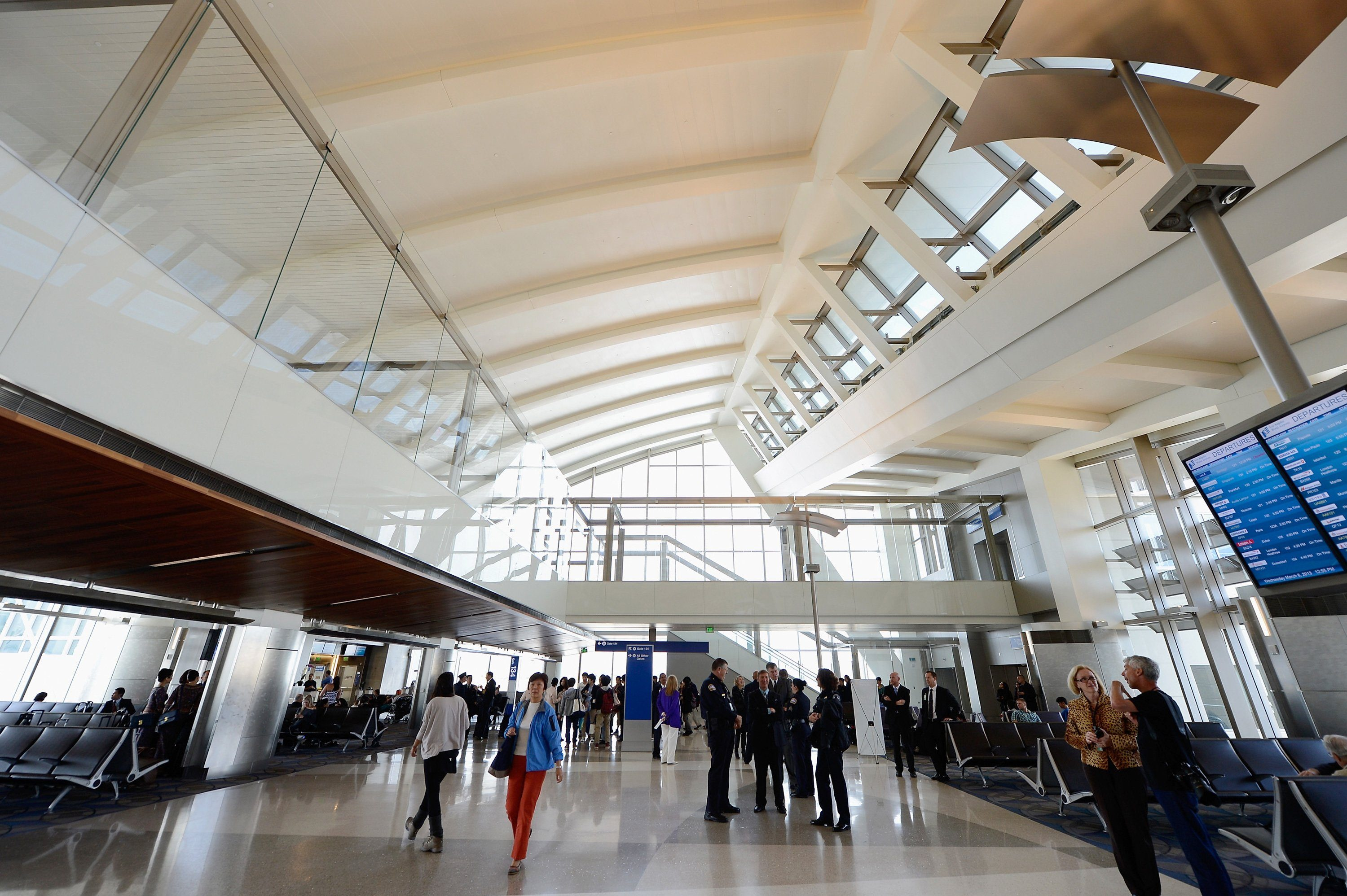 People walk through the north concourse of the new Tom Bradley International Terminal during its unveiling at Los Angeles International Airport on March 6, 2013 in Los Angeles, California.