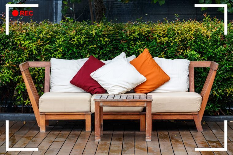 outdoor couch with cushions and pillows.