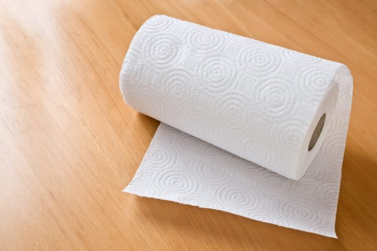 paper towel roll on wood background
