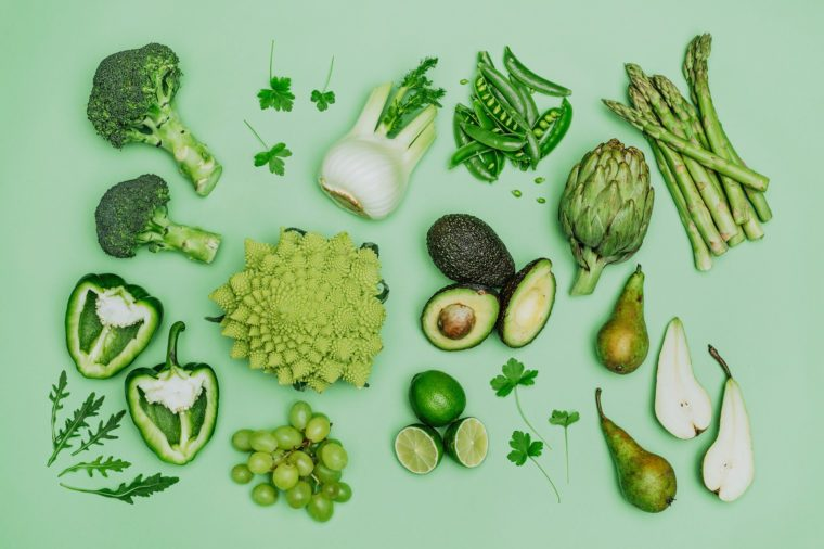 Green vegetables on green background shot from above over head