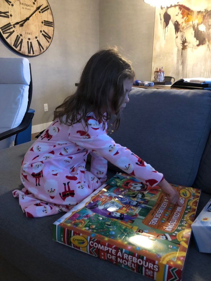 Girl opening and advent calendar