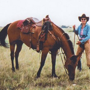 Janie (J.F.) and her beloved horse, Skookum Cat, in 1997